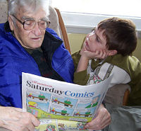 Reading the most important part of the newspaper to my grandson