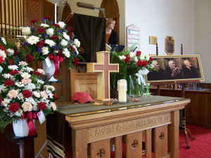 Pam prepares before the funeral. Mike made a cross-shaped urn for his father's ashes.