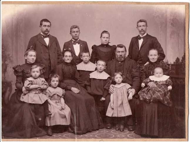 Maren and Peter Povlsen with their family. Karen is seated on the right with baby Peter, her husband behind her.
